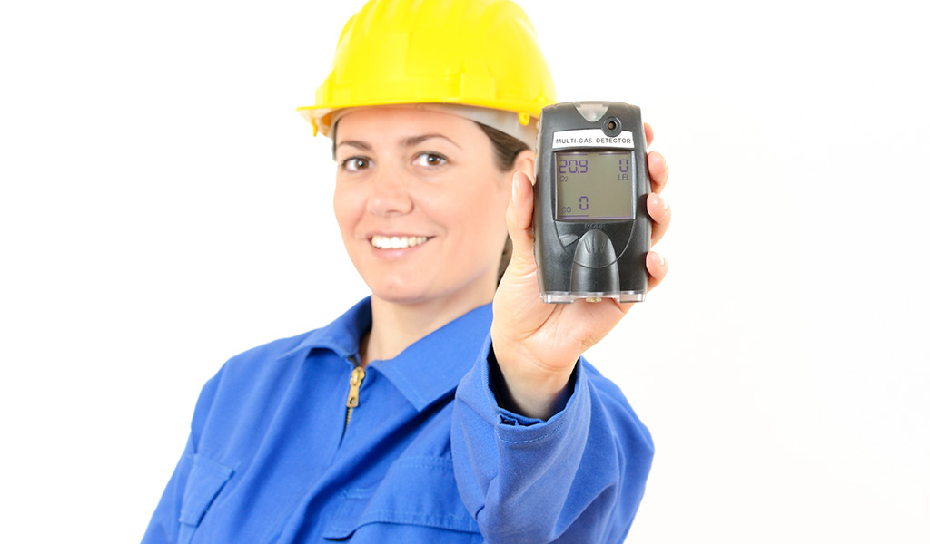 Woman holding a multi-gas testing device